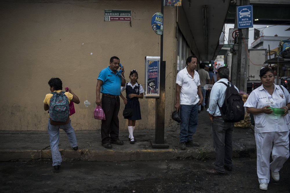 Residents make their way to school and work early in the morning on May 25, 2016 in Poza Rica Veracruz.   Nine days before this pictures was taken two men drove up to this intersection early in the morning, got out of their car, and executed a man standing on the corner. A similar incident happened the following week in the same area.   Lying in the heart of the country's land based oil reserves, Poza Rica is a major center for the country's oil industry. But as cartels diversify their business, oil theft and the black market have become big business. Murder, kidnapping, and extortion have followed.