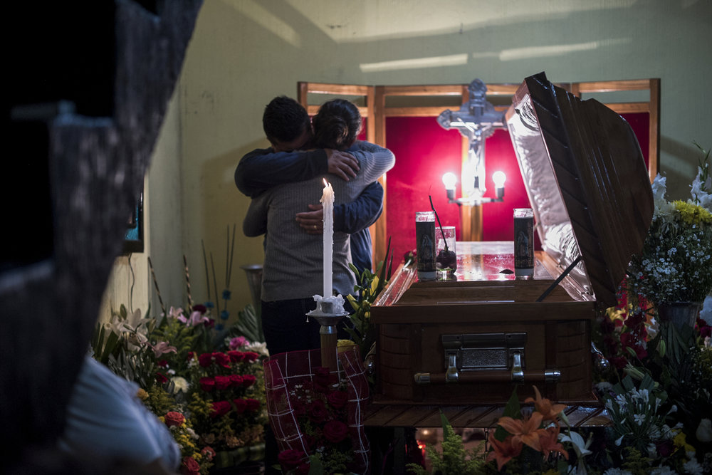 Pedro Tamayo's casket sits in his family's home before being taken to the cemetery on July 22, 2016 in Tierra Blanca, Veracruz.  Among the thousands killed in Veracruz over the past few years are dozens of journalists. In one now famous incident, photojournalist Ruben Espinosa was tortured and executed along with human rights activist Nadia Vera in Mexico City after both had fled Veracruz fearing for their lives. Vera had left a video saying that if anything happens to her the Governor Duarte and his cabinet are responsible.