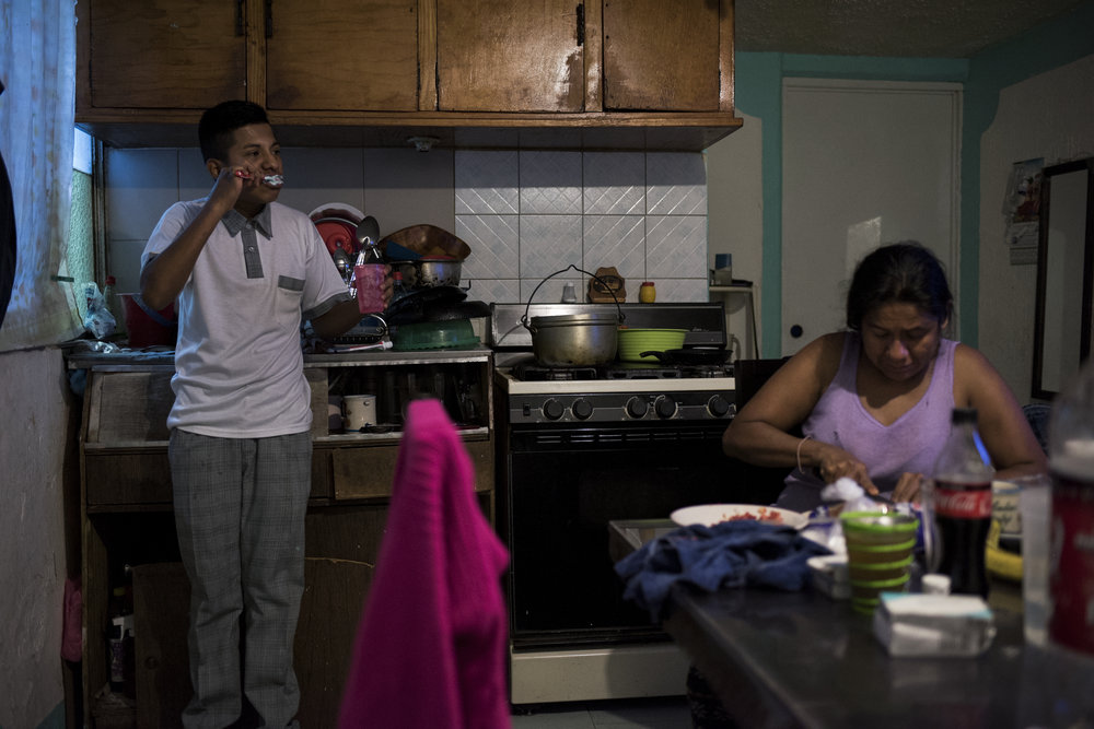 Pancho brushes his teeth in the morning before school on March 3, 2017 in the Morelos neighborhood of Mexico City. Pancho lives at home with his mom, dad, two sisters, and his niece in a small two room apartment.