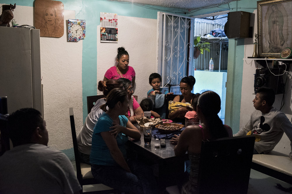 A friend and her new born baby visit Pancho and his family during dinner on February 28, 2017 in the Morelos neighborhood of Mexico City. Pancho lives at home with his mom, dad, two sisters, and his niece in a small two room apartment.