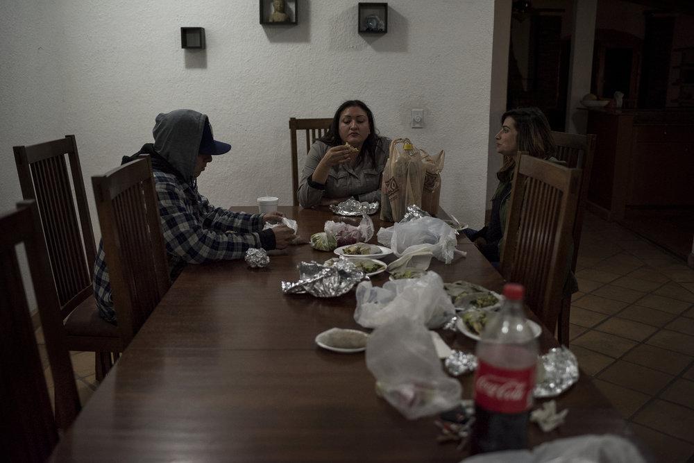 Ortega (left), eats dinner with Ibogaine Institute staff members.