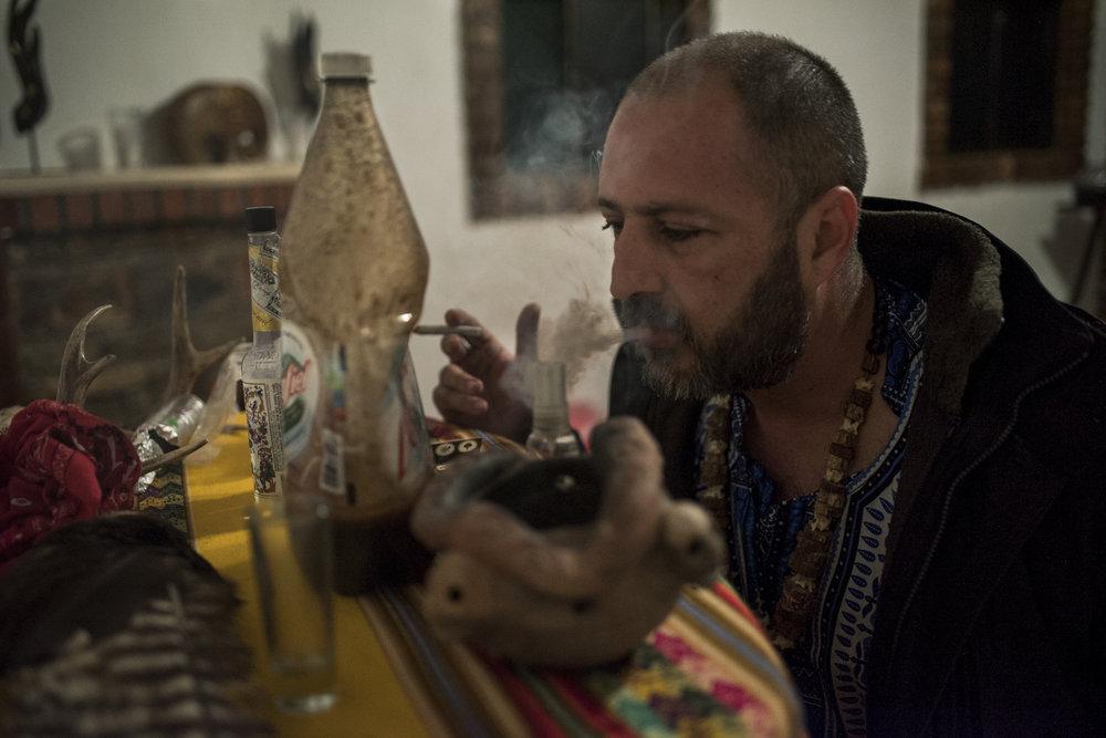 A shaman prepares an ayahuasca ceremony for Andrew Ortega.