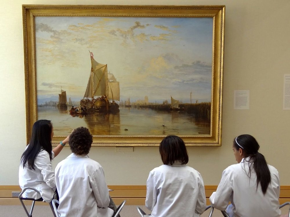 Medical students studying J.M.W. Turner's Dort or Dordrecht: The Dort packet-boat from Rotterdam (1818) at the Yale Center for British Art, New Haven. Photo by Adam Jones, via Flickr.