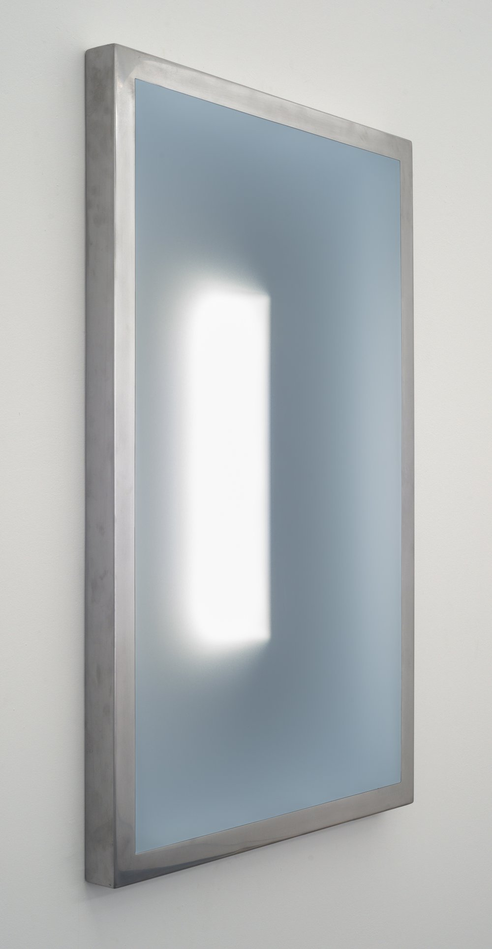 """(24""""H x 18""""L x 1.5""""W,view from left side)    This three dimensional wall piece, constructed out of steel, acrylic, and LEDs captures the viewer's attention by creating a calm, meditative, and introspective atmosphere. The clarity of the illuminated elusive interior shape shifts depending on the viewer's physical relationship to the piece."""