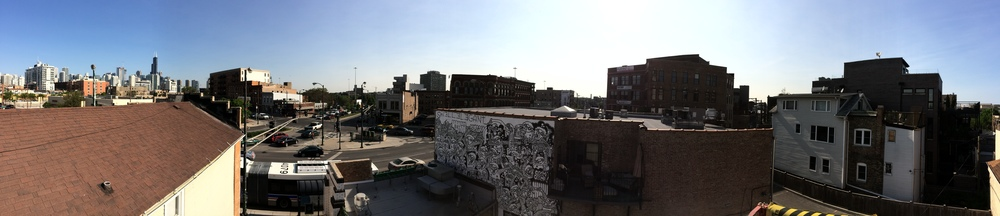 A PANORAMIC VIEW. YOU CAN SEE THE SEARS TOWER TO THE LEFT AND THE MURAL IN THE MIDDLE OF THIS SHOT.