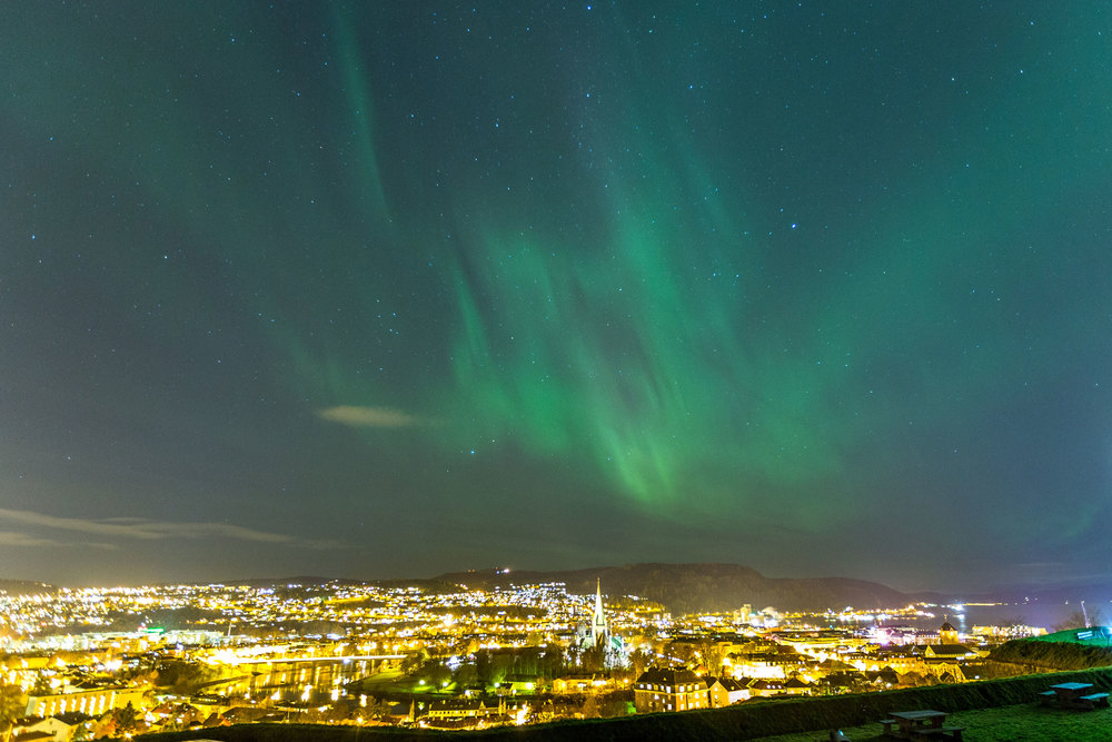 Aurora Borealis, also called Northern Lights, above the city centre of Trondheim, Norway.