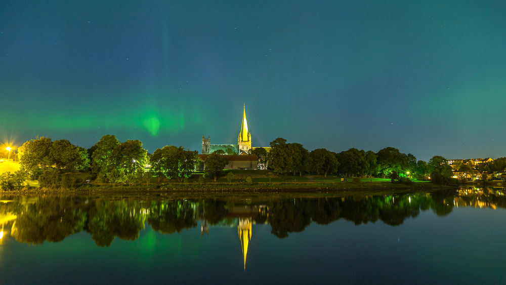 Aurora Borealis, Northern lights , at  Nidarosdomen Cathedral .  Nidarosdomen Cathedral wanted a shot of the cathedral with the Northern lights as a backdrop for commercial purpose (postcards, fridge door magnets etc.). Nearly an impossible task, but I told them that I would do my best. I was very lucky, only a few days later all conditions was perfect. Northern lights, clear skies, high tide and crystal clear water. This is a very rare capture of an incredibly bright Aurora Borealis. This is not the actual photo they picked, you can buy it at the cathedral's souvenir shop.