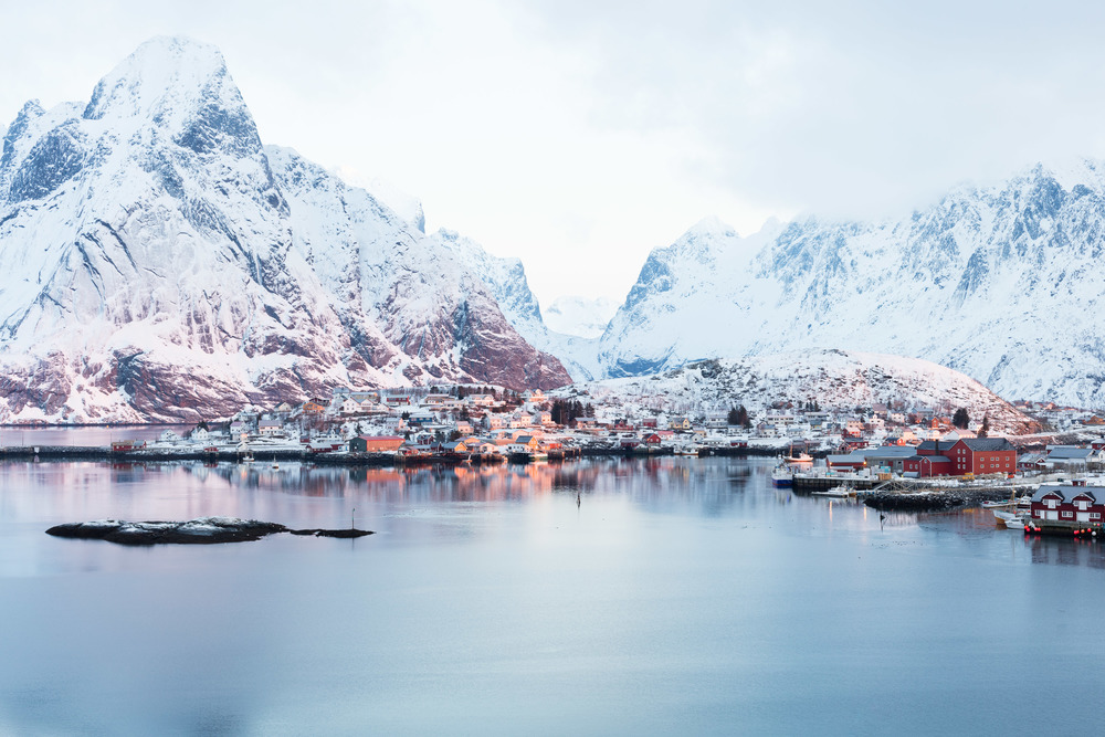 Reine, Lofoten. The sun is just above the horizon and creates the magic arctic light.