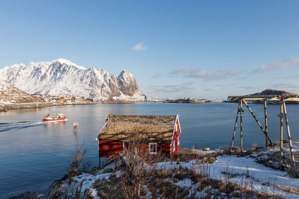 Reine, Lofoten. A local fishing boat on the way to fresh cod fishing. There is a lot of cod in the sea around Lofoten islands at this time of year.