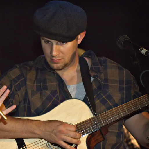 TOM WEBSTER, GUITAR, LEAD VOCALS