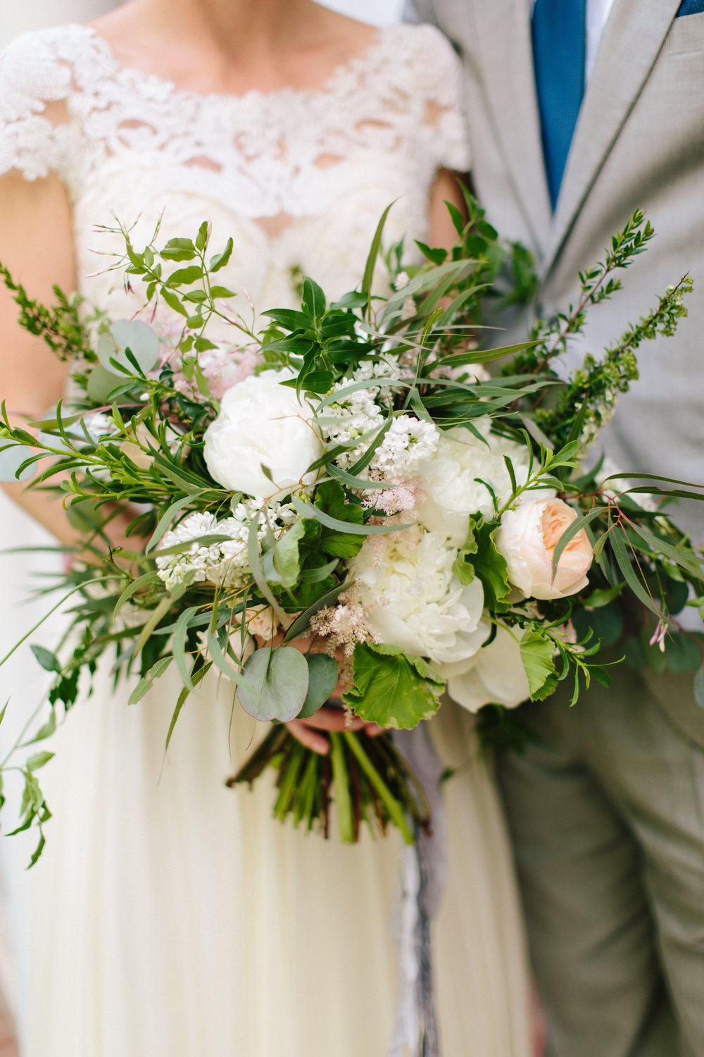 Loose Spring bridal bouquet with peonies
