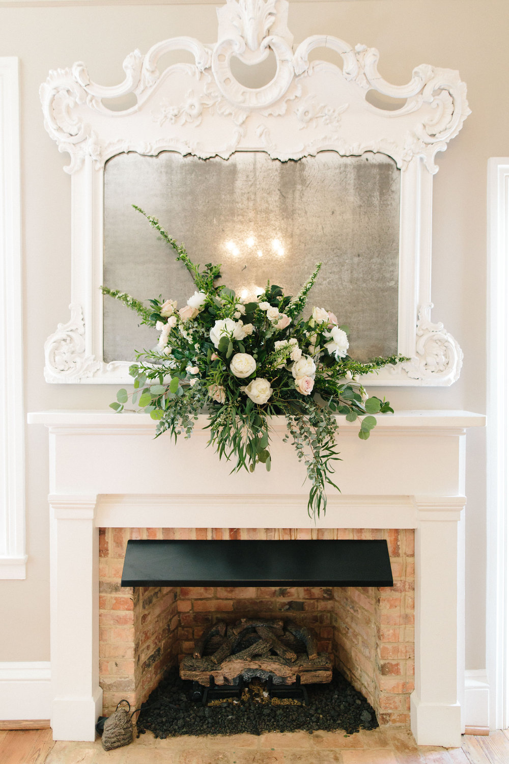 Mantle fireplace flower arrangement