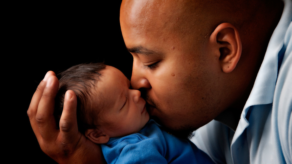 father kissing baby.jpg