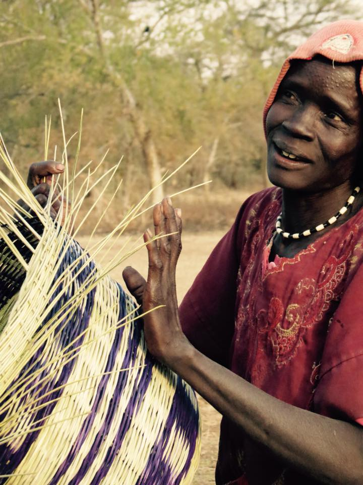 Achan tonj makes a basket in the village of Aker adoor.