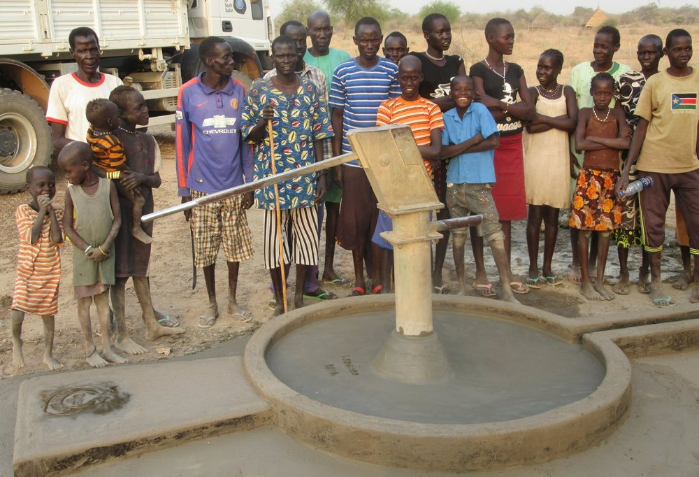 villagers celebrate repaired well, ensuring a future with access to fresh water