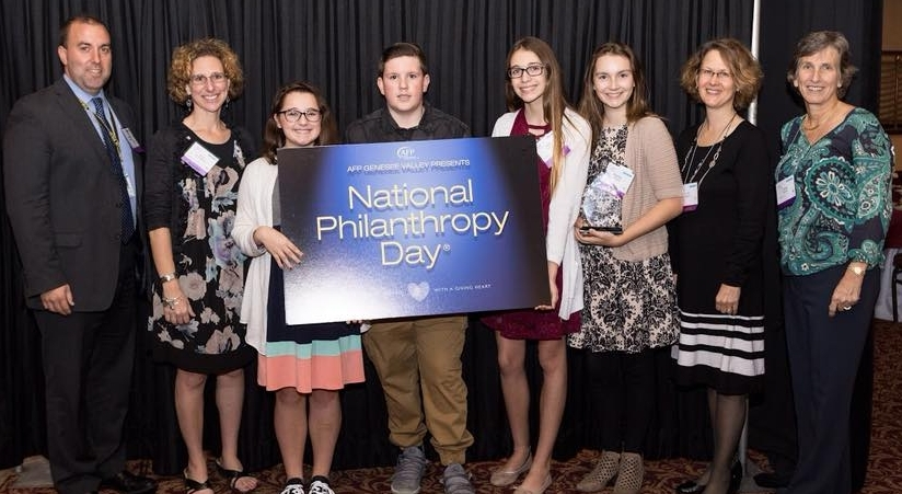 Greece Athena principal Jason Fulkerson, teacher Vicki Richardson, students Ellie Dermody, Elliot Honan, Halie Cardon, Audrey Coons with WFSS Executive Director Lynn Malooly and WFSS Board member Laura Hayden at AFP Awards Luncheon.