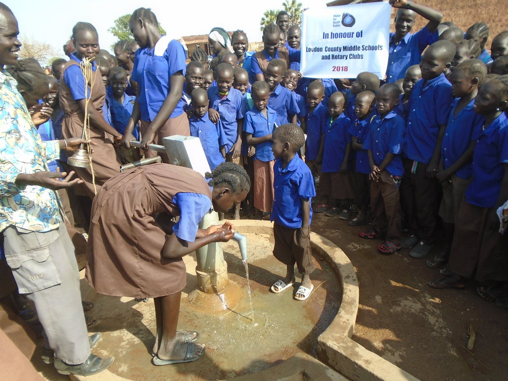 STUDENTS AT ZAGALONA PRIMARY SCHOOL, SITE OF WFSS'S PILOT SANITATION PROJECT, ENJOY FRESH WATER FROM THEIR NEW WELL, THE FIRST DRILLED IN THE 2017-18 SEASON.