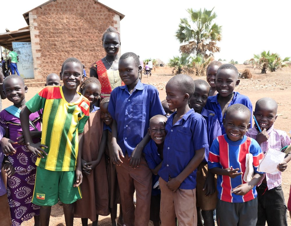Students at Zogolona Primary School in Wau, site of a new WFSS well and new latrines being constructed.