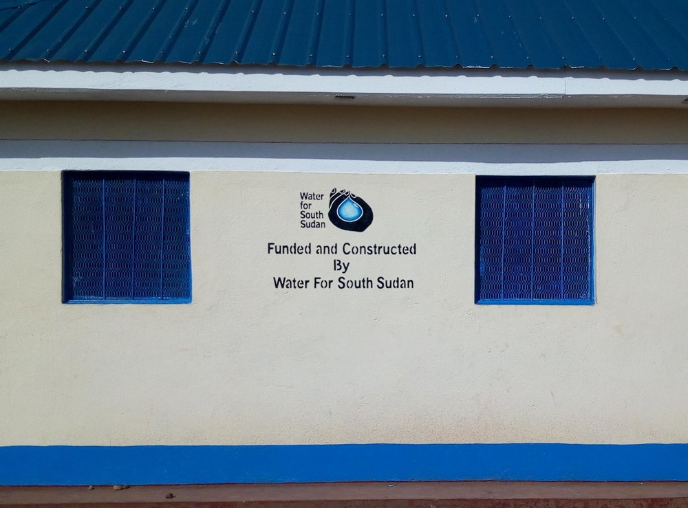 the Finished latrine building was handed over to the school in june