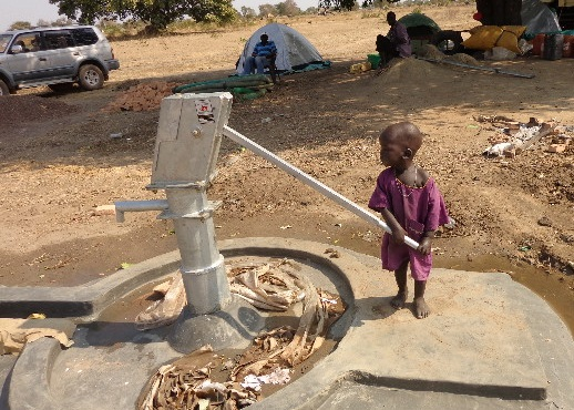 Little girl at well.jpg