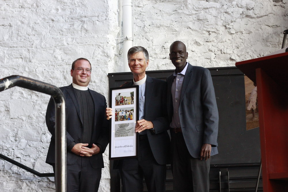 Reverend Rob Picken and Reverend Frederic Reynolds accept the  Founder's Award  on behalf of St. Paul's Episcopal Church.