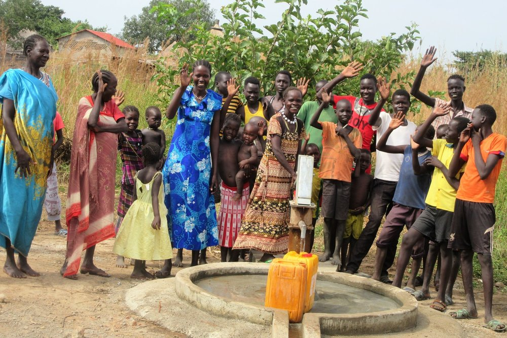 Villagers in Jur River County show their appreciation to WFSS for repairing their well.