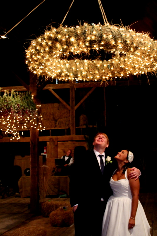 Barn Wedding Interior, hanging wreath lit with lights