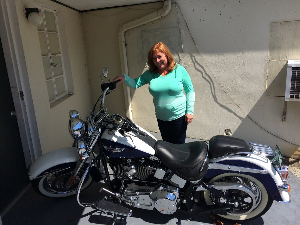 One of the owners of  Papa T's  and her Harley