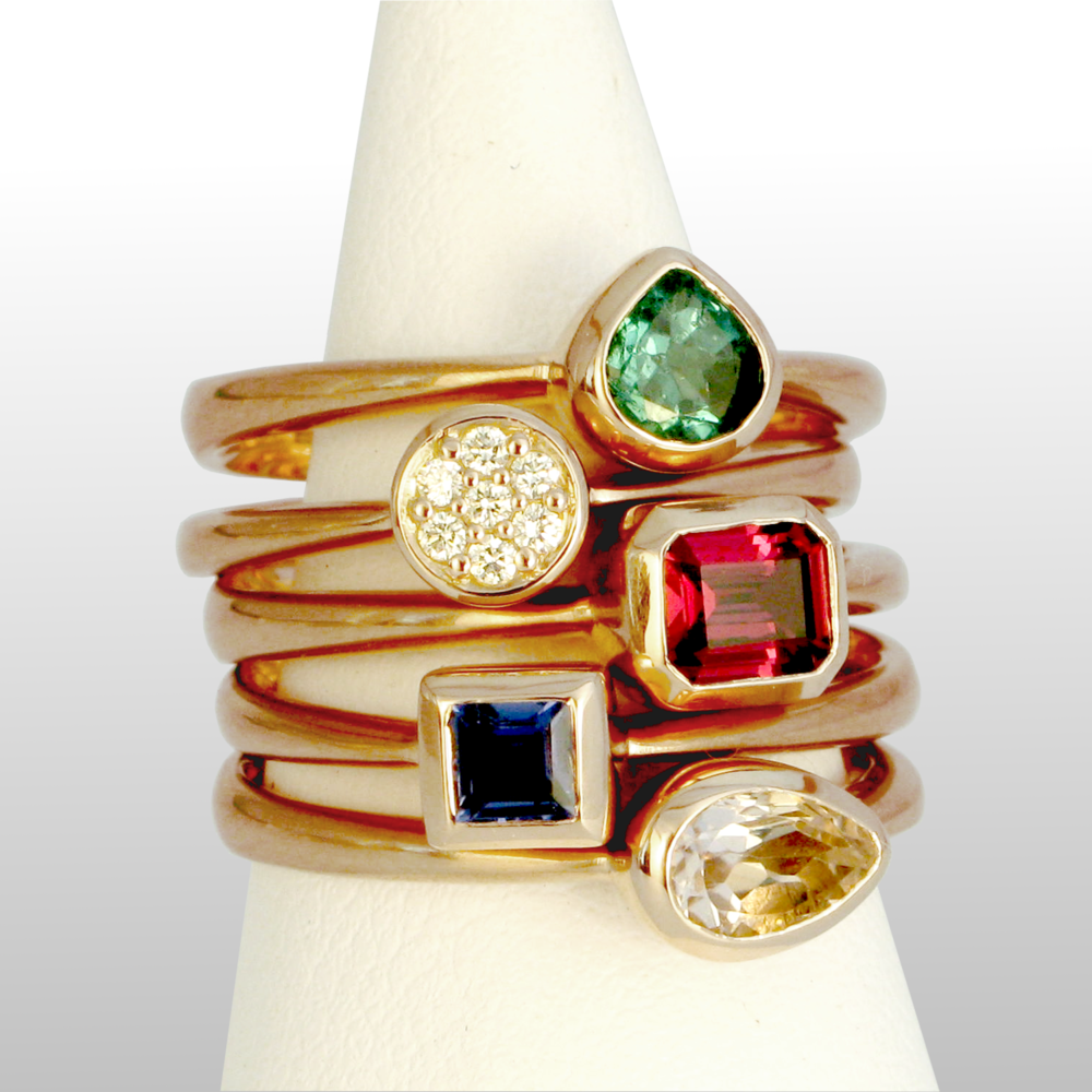 Stackable designer rings in 18k rose gold 'Stax' with diamond pavé, tourmalines and sapphire by Pratima Design Fine Art Jewelry