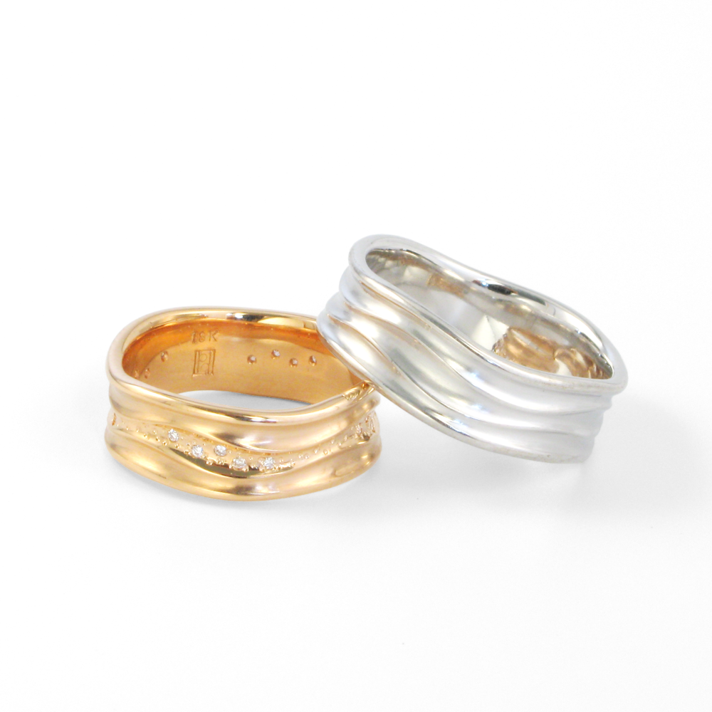 Contemporary wedding band set -his and hers- in 18k rose and white gold 'Stardust' with diamonds by Pratima Design Fine Art Jewelry