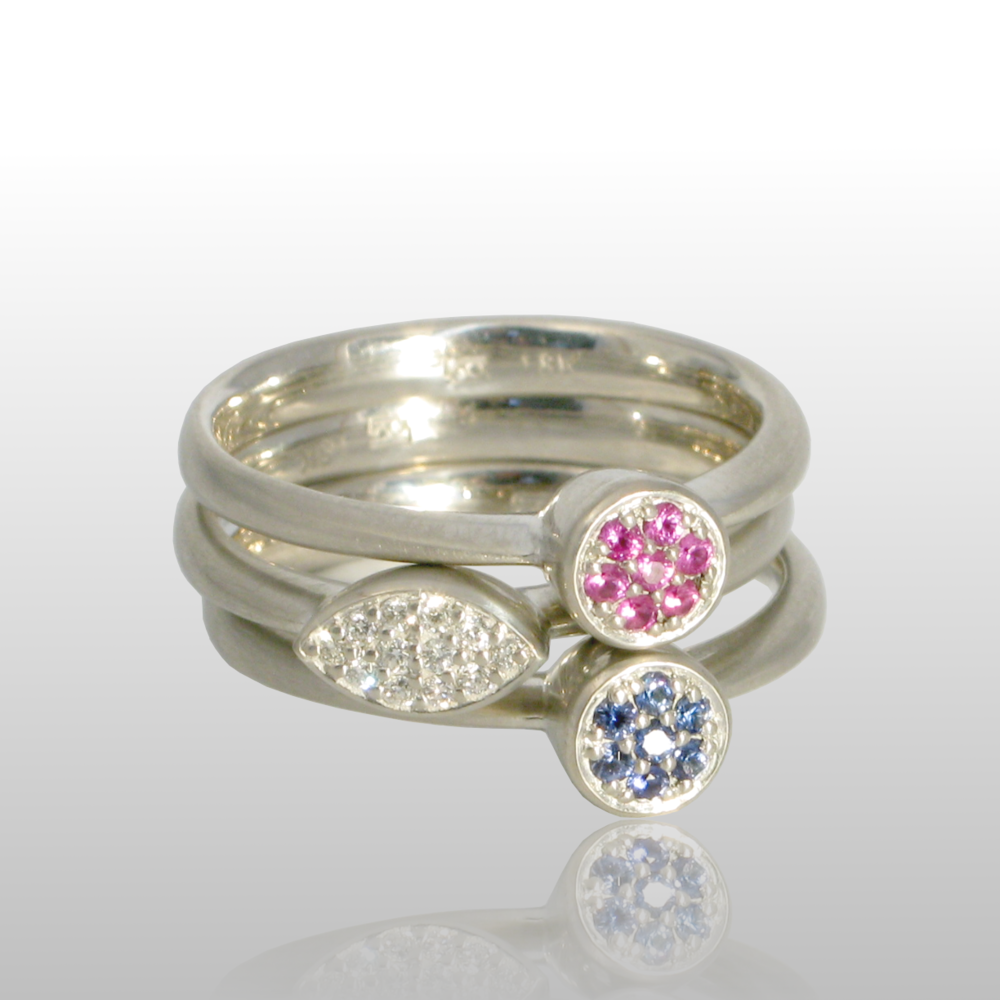 Stackable designer rings 'Stax' in platinum or 18k white gold with diamond and pink and blue sapphire pavé by Pratima Design Fine Art Jewelry