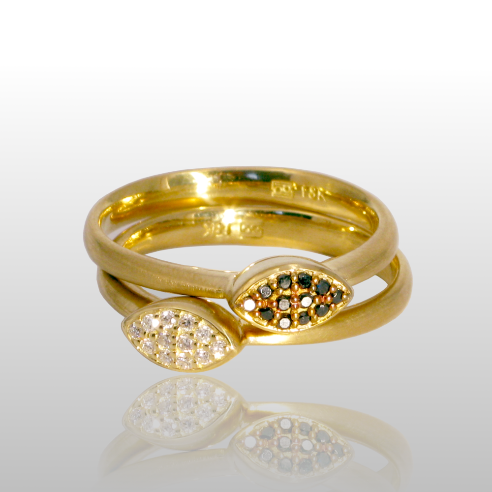 Stackable designer rings 'Stax' in 18k gold with white and black diamond pavé by Pratima Design Fine Art Jewelry