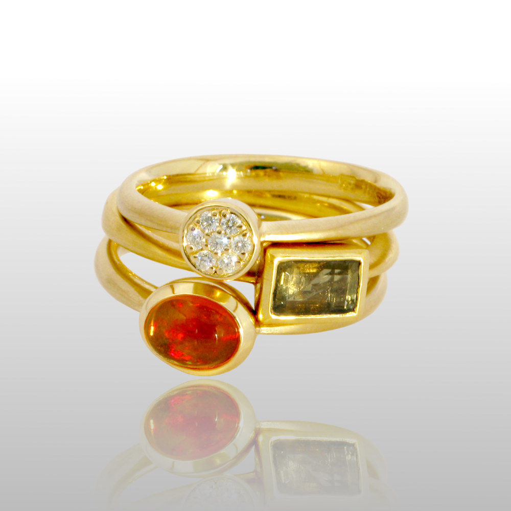 Stackable designer rings in 18k gold 'Stax' with diamond pavé, tourmaline and fire opal by Pratima Design Fine Art Jewelry