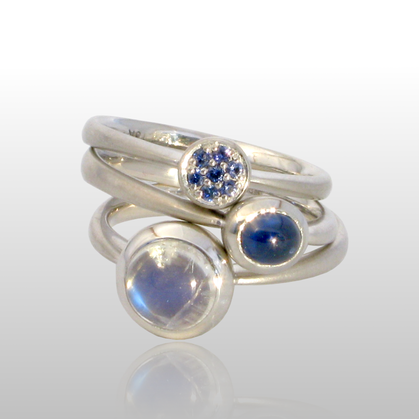 Stackable designer rings in 18k white gold 'Stax' with blue sapphire pavé, blue sapphire and blue moonstone by Pratima Design Fine Art Jewelry
