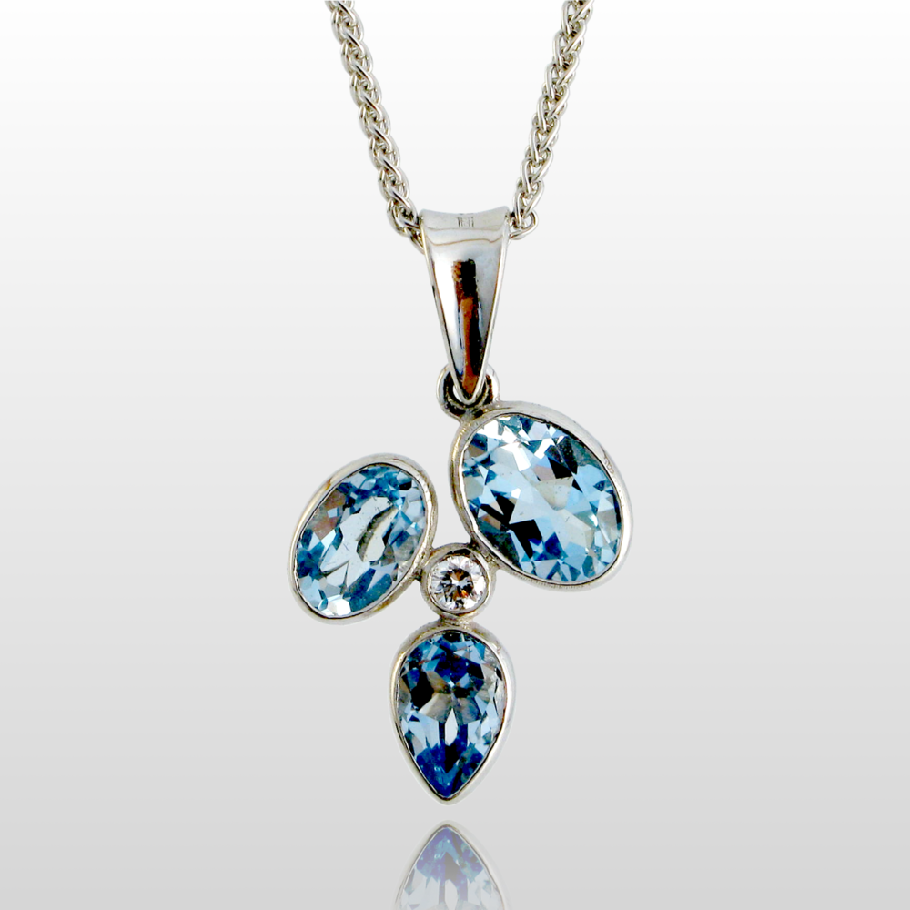 18k White Gold Mini 'Kaleidoscope' Pendant with Sky Blue Topazes and a Diamond by Pratima Design Fine Art Jewelry
