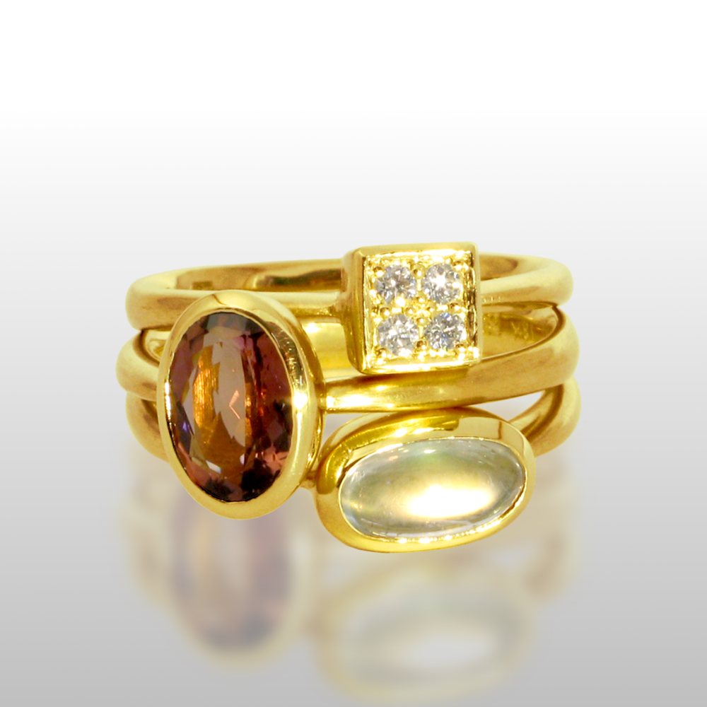 Stackable designer rings 'Stax' in 18k with diamond pavé, tourmaline and rainbow moonstone by Pratima Design Fine Art Jewelry