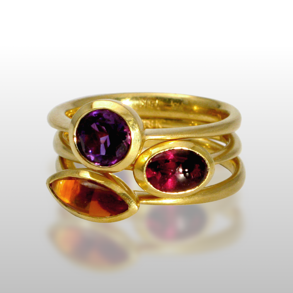 Stackable designer rings in 18k gold 'Stax' with amethyst, garnet and citrine by Pratima Design Fine Art Jewelry