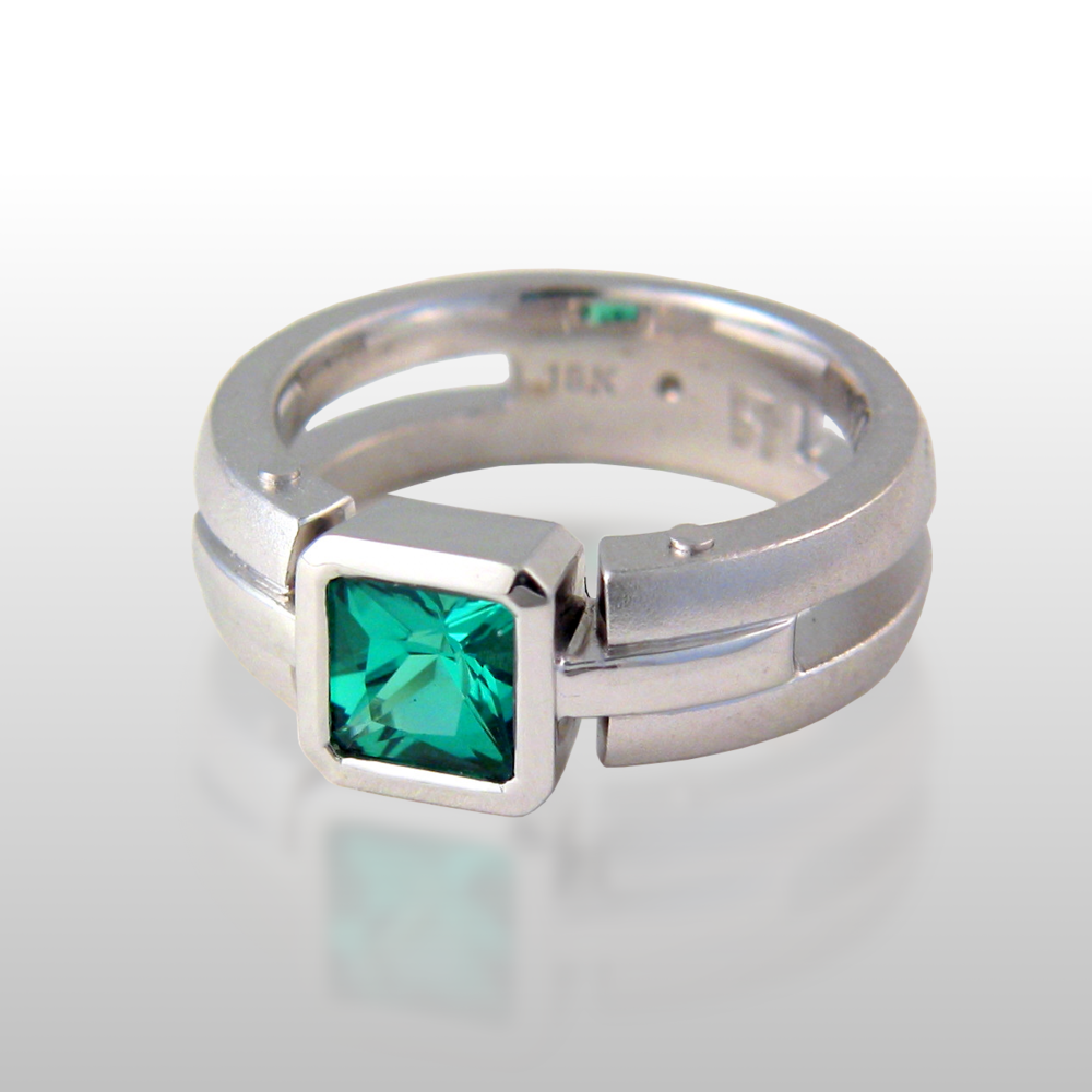 Contemporary 18k white gold ring 'Millennium' with a green tourmaline and diamond by Pratima Design Fine Art Jewelry