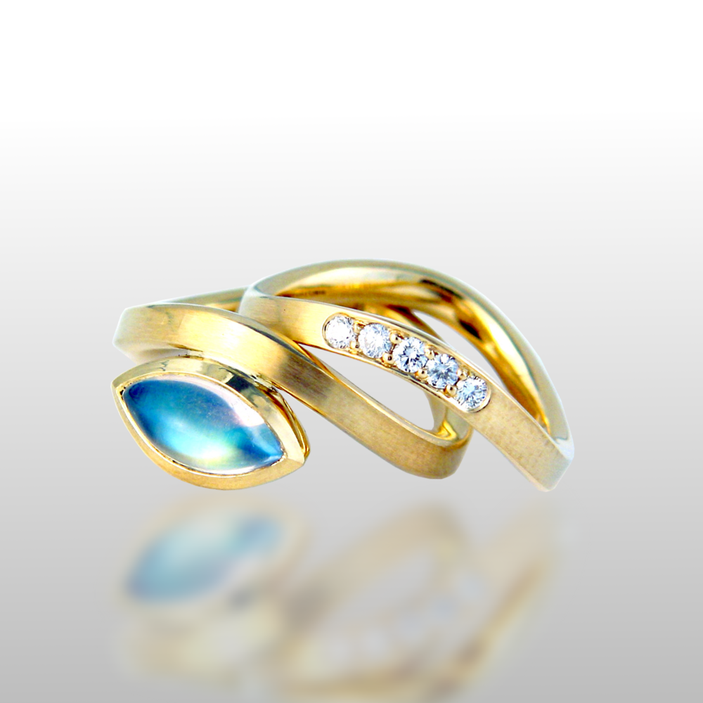 Contemporary 18k gold wedding band set 'Synergy' with rainbow moonstone and diamonds by Pratima Design Fine Art Jewelry