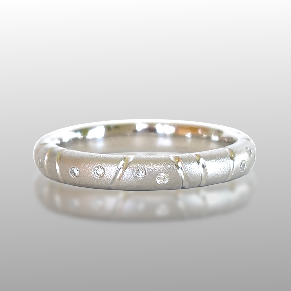 Platinum Stacking Eternity Band sprinkled with Flush Set Diamonds from the 'Momenti' Collection by Pratima Design Fine Art Jewelry