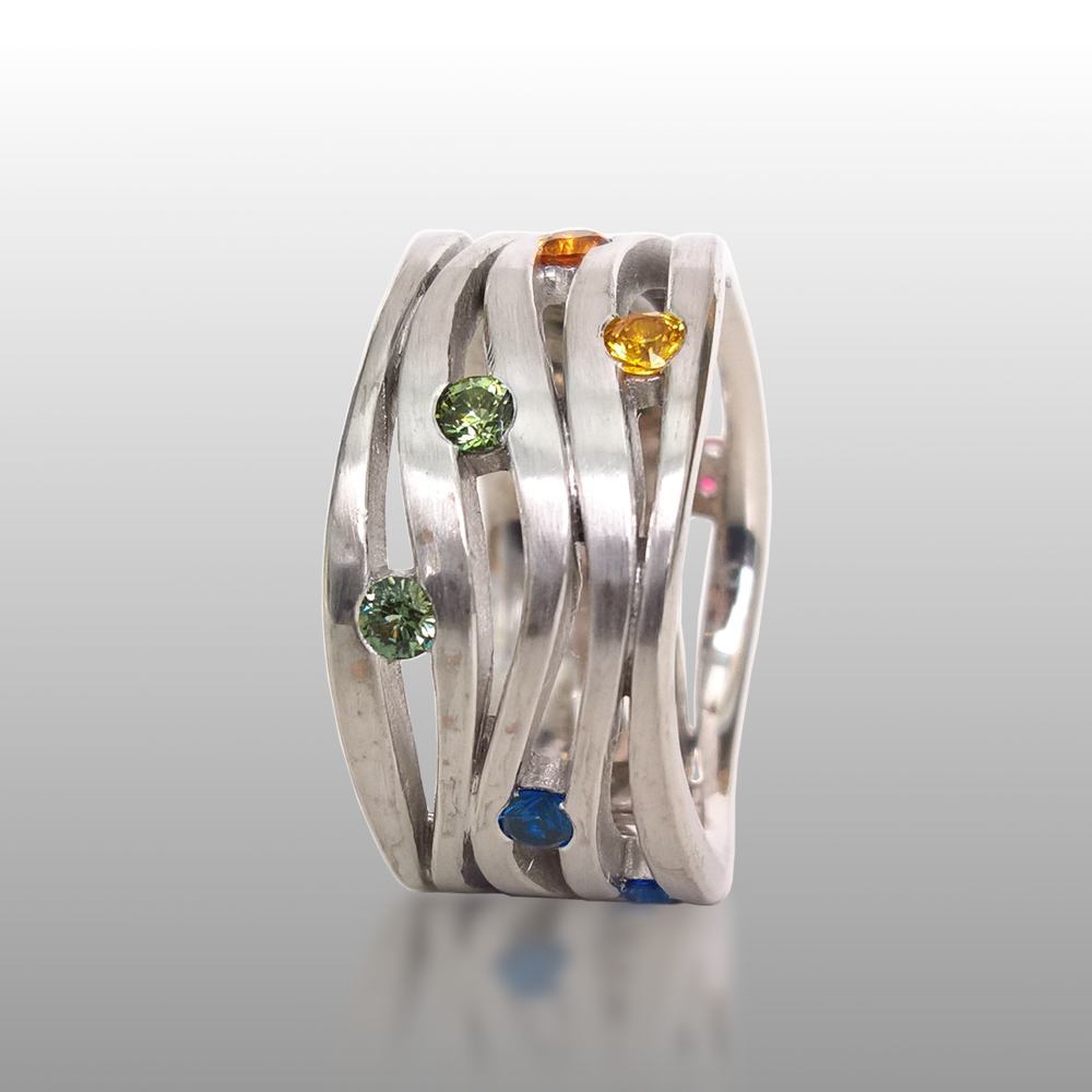 Rainbow sapphire wave ring 'Lamello' in platinum by Pratima Design Fine Art Jewelry Maui