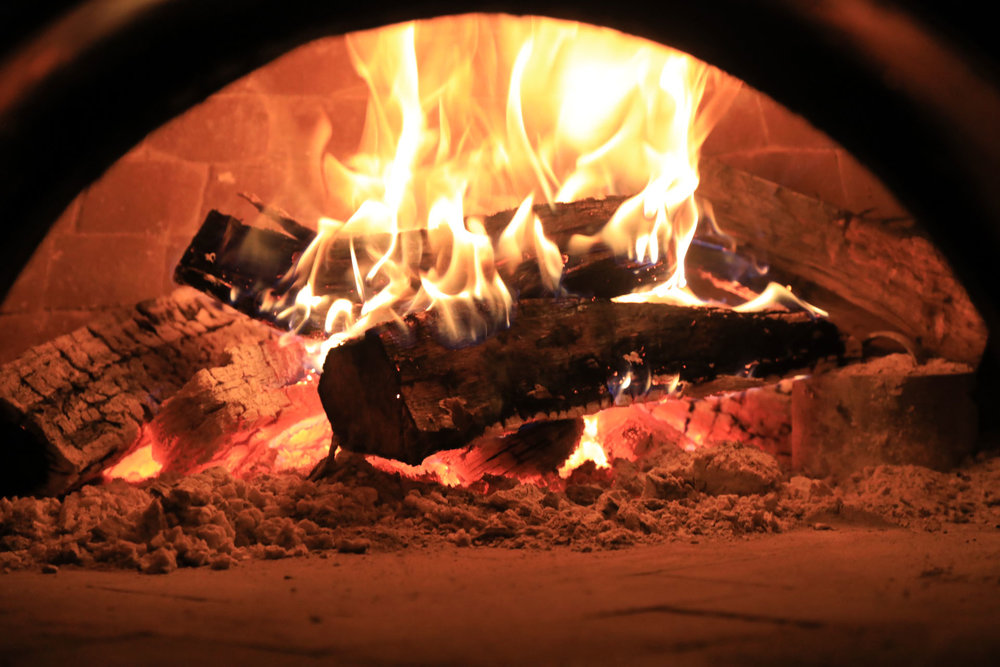 Fire inside a pizza oven