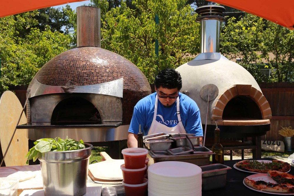Oenotri cooking pizza for BottleRock on a Forno Piombo oven