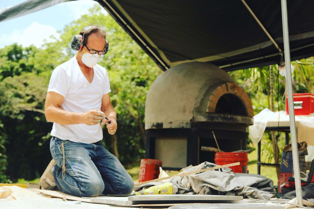 Guy Piombo working on a pizza oven