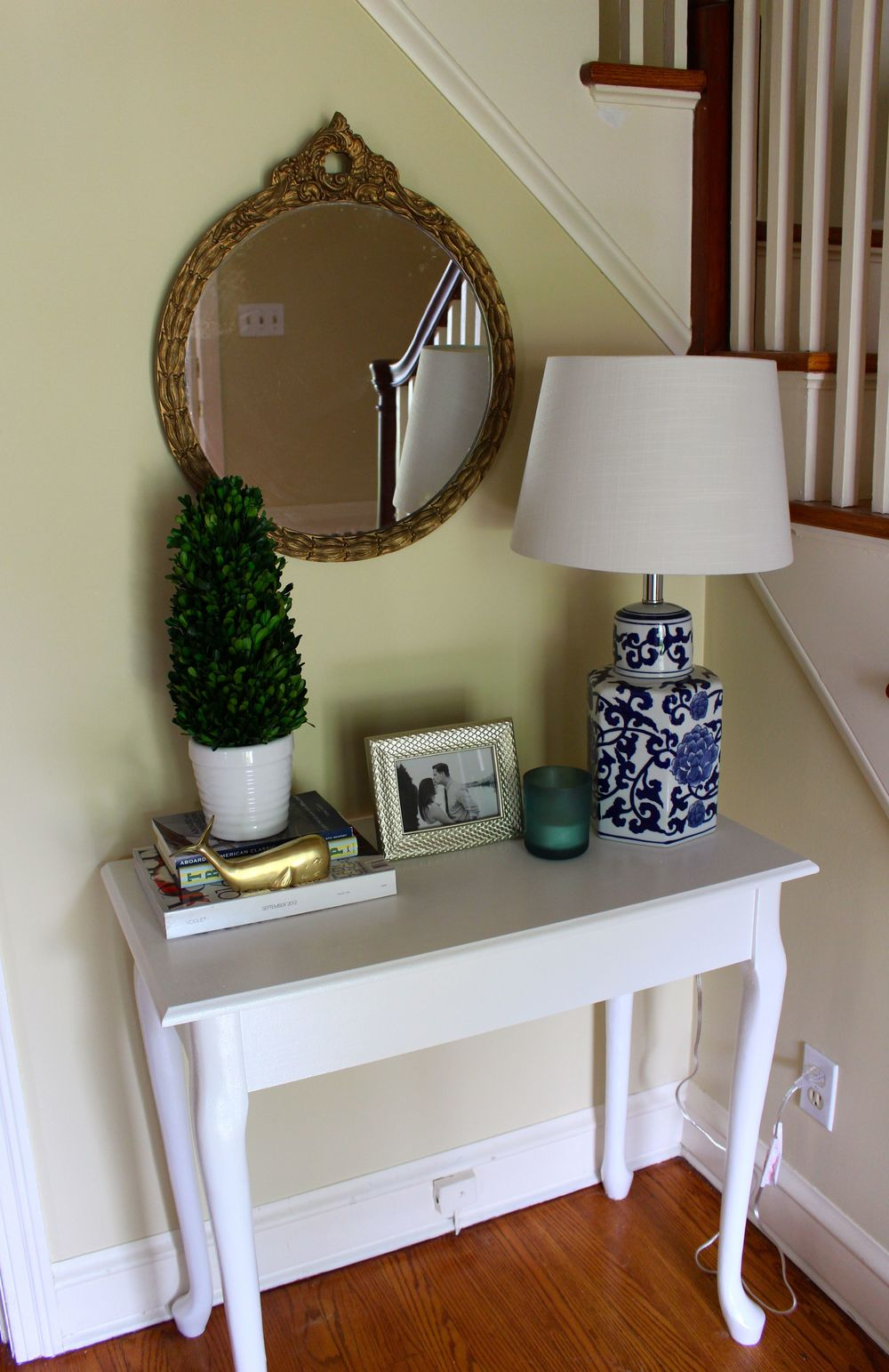 This table was Chris' grandma's old makeup table... we flipped the top around to cover mirror holes and painted it!