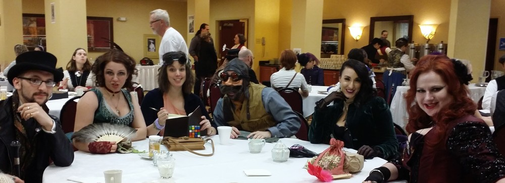 "Members of S.W.A.R.M., which I met in the Tea Room, one of the neutral areas of the convention - meaning both ""good guys"" and ""villains"" can mix without issue."