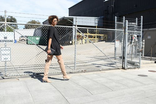 Tall Georgette Wrap Tunic - Long Tall Sally/Lexy Over-The-Knee-Boots - SMASH SHOES (come in size 10-13 in beige and black)/Skirt, bracelet and Clutch - H&M/Sunnies - Forever 21 Photo Credit: Meg Russell