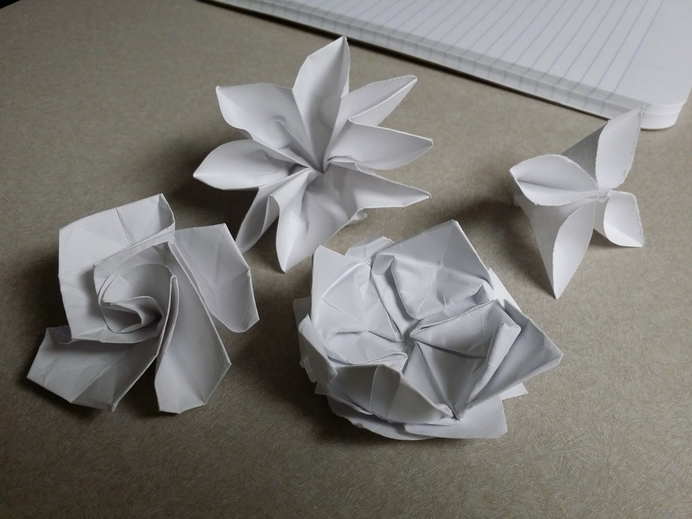 Some of the contenders for paper flower. We went with the simple design on the right.