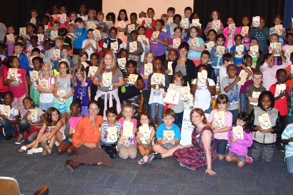 All 125 second graders at Southern Pines Primary School received a copy of Dory Dory Black Sheep -- a gift from the Literacy Fundraising Committee at the Southern Pines Rotary Club.  The other adults in the picture are Angie Tally from The Country Bookshop who applied for the grant and Sue Bruton from the Southern Pines Rotary Club.  I was hugely honored to be a part of this enormous gift.