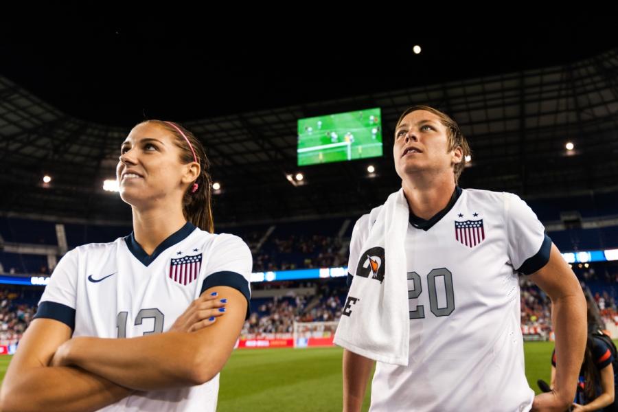 USA women's players Morgan and Wambach.